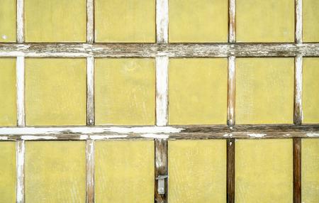 Background of vintage garage door with multiple panels