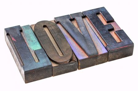 love  - isolated word abstract in vintage wooden letterpress type blocks, stained by color ink Stock Photo