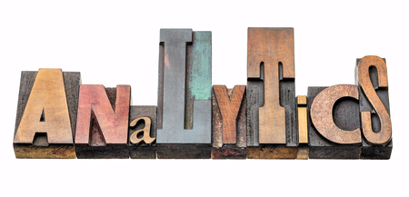 analytics word - isolated  text in vintage letterpress wood type stained by color inks, mixed fonts Stock Photo
