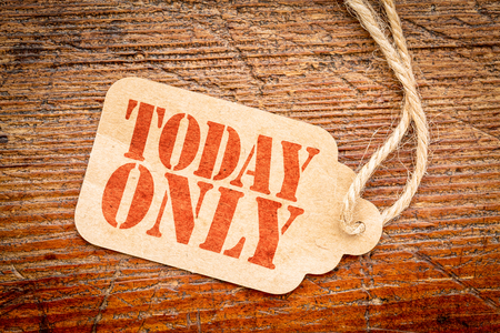 today only  sign - red stencil text on a cardboard price tag against rustic wood