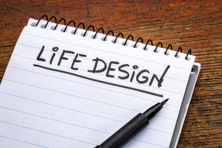 life design - handwriting in a spiral notebooks against grunge wood Stock Photo