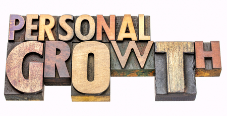 personal growth - isolated word abstract in vintage letterpress wood type blocks, mixed fonts