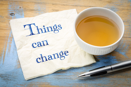 things can change - handwriitng on napkin with a cup of tea