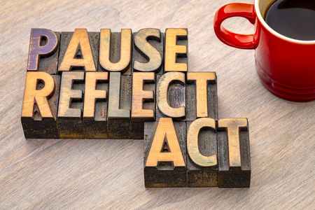 Pause, reflect, act concept - word abstract in vintage letterpress wood type printing blocks with a cup of coffee