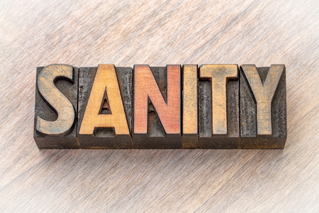 sanity - word abstract in vintage lettepress wood type printing blocks Foto de archivo - 105750889