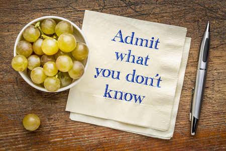 Admit what you do not know advice - handwriting on a napkin with grapes Foto de archivo - 104646938