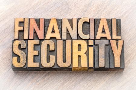 Financial security - word abstract in vintage letterpress wood type blocks