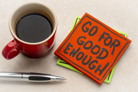Go for good enough reminder note with a cup of coffee