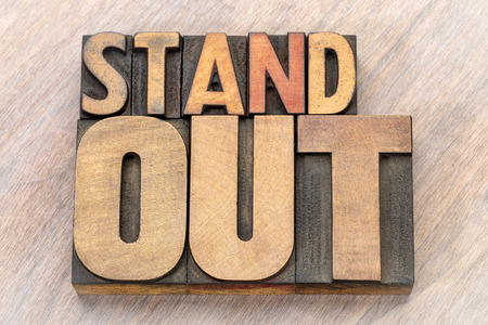 stand out word abstract in vintage letterpress  wood type Stock Photo