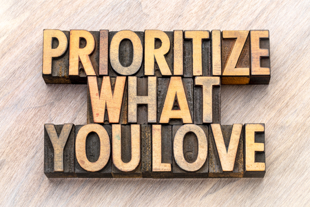 prioritize what you love - word abstract in vintage letterpress wood type Stock Photo