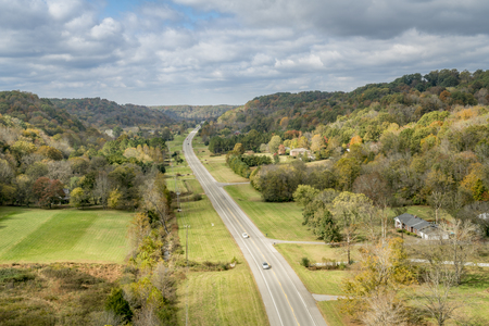 Tennessee highway 96 as seen from Double Arch Bridge at Natchez Trace Parkway near Franklin, TN, fall scenery Фото со стока