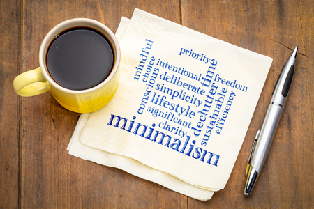 Cloud of words associated to minimalism as a lifestyle - handwriting on a napkin with a cup of coffee 스톡 콘텐츠