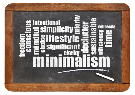 cloud of words associated to minimalism as a lifestyle - white chalk text on a slate blackboard