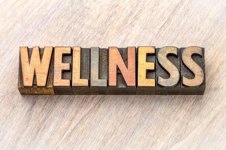 wellness - word abstract in vintage letterpress  wood type printing blocks