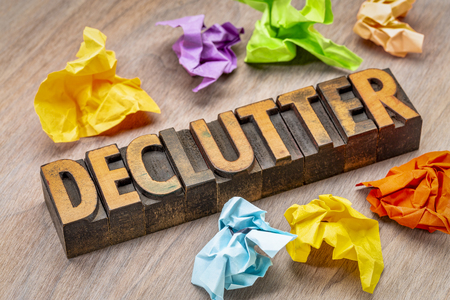 declutter - abstract in vintage letterpress wood type blocks with crumpled sticky notes Stockfoto - 105147730