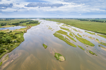 aerial view of shallow and braided Platte River near Kearney, Nebraska in summer scenery