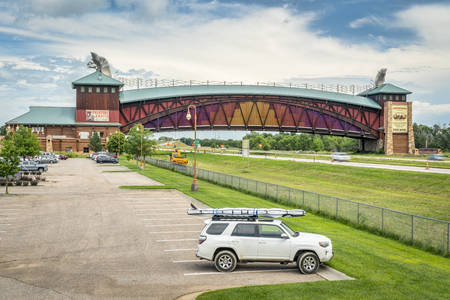 Kearney, NE, USA - July 30, 2018: Toyota 4Runner SUV (2016 trail model) with a stand up paddleboard on rood racks in front of Great Platte River Road Archway Monument..