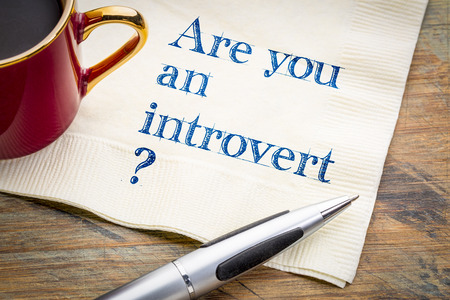 Are you an introvert? Handwriting on a napkin with a cup of coffee.