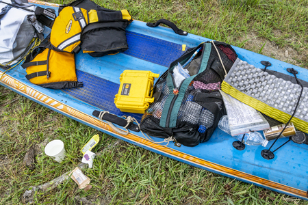 St Charles, MO, USA - July 26, 2018: Messy deck of a stand up paddleboard (All Star by Starboard) at a finish of the annual Missouri River 340 race from Kansas City to St Charles after 57 hours of nonstop paddling.