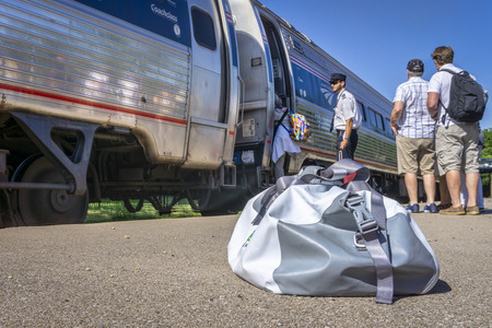 Kirkwood, MO,  USA - July 27, 2018: Passengers are boarding a morning Amtrak train, Missouri River Runner, from St Louis to Kansas City . Editorial