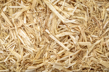 Close-up of dry raw straw bale background