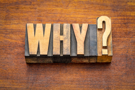 Why question in vintage letterpress wood type against rustic wooden board Stock Photo