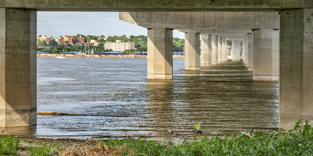 Alton cityscape as seen from under the Clark Bridge acroos the MIssissipi River. Banque d'images