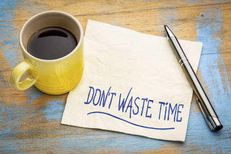 Do not waste time - inspirational handwriting on a napkin with a cup of coffee