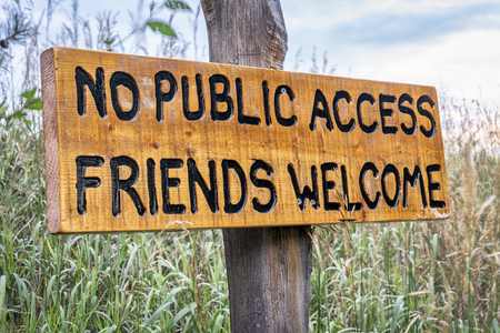 No public access, friends welcome - wooden sign in forest
