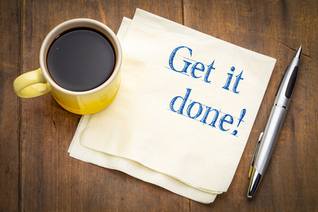 Get it done advice or reminder - handwriting on a napkin with a cup of coffee