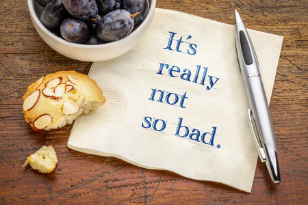 It is really not so bad - positive text on a napkin with grapes and cookie