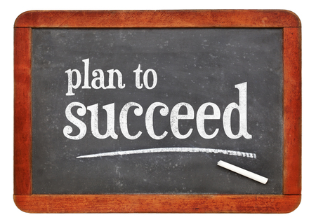 Plan to succeed motivational concept - white chalk text on a vintage slate blackboard