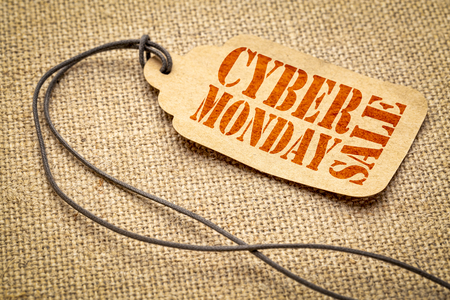 Cyber Monday Sale sign - a paper price tag with a twine iagainst burlap canvas Stock Photo