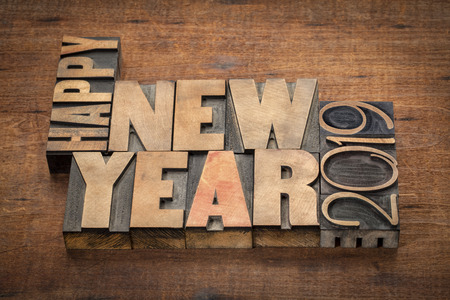 Happy New Year 2019 greeting card  - word abstract in vintage letterpress wood type blocks on a grunge wooden background