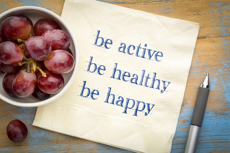 Be active, be healthy, be happy   inspirational concept -  handwriting on a napkin with fresh grapes