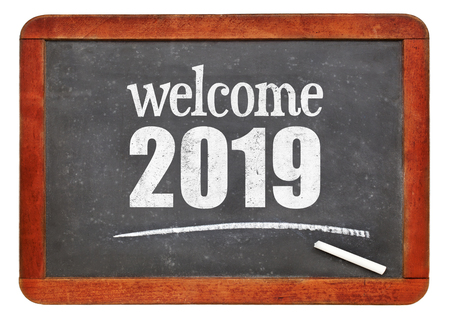 Welcome 2019 - New Year concept on a vintage slate blackboard isolated on white Stock Photo