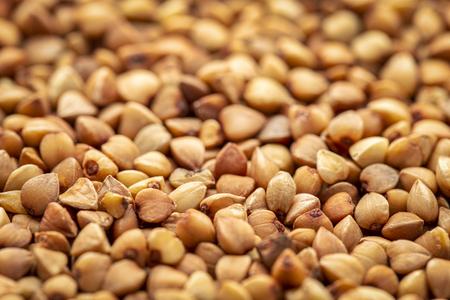 Background and texture of roasted buckwheat kasha - gluten free grain, selective focus Stock Photo