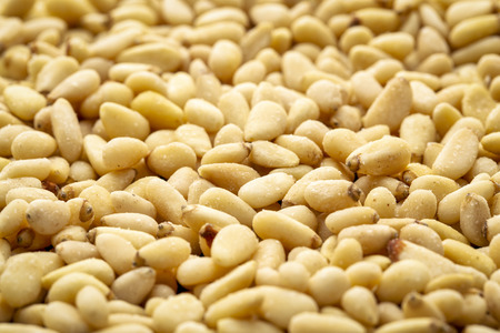 Background of pine nuts with a selective focus