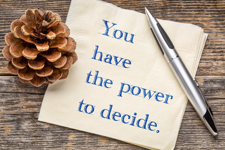 You have the power to decide - inspirational handwriting on a napkin against rustic wood Stock Photo