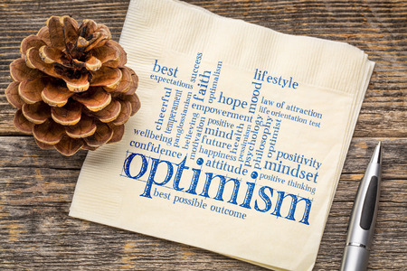 Optimism word cloud - handwriting on a napkin Stock Photo