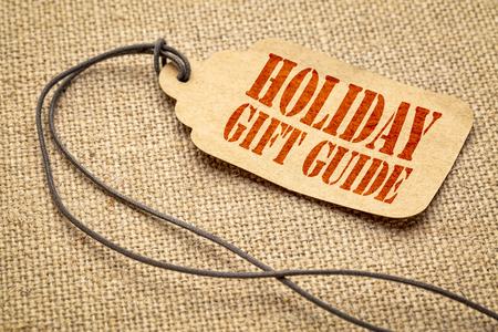 Holiday gift guide sign - a paper price tag with a twine iagainst burlap canvas