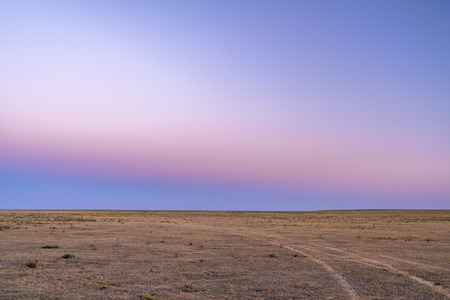 Typical clear sky after sunset over prairie in northern Colorado - Pawnee National Grassland Stock Photo