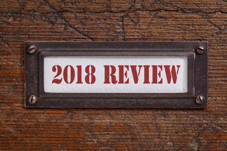 2018 review - a label on grunge wooden file cabinet. A passing year summary and review concept. Stock Photo