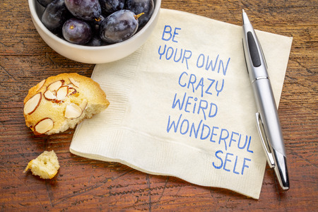 Be your own crazy, weird, wonderful self - inspirationla handwriting on napkin with grapes and cookie Banco de Imagens