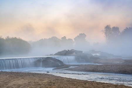 Morning fog over a river diversion dam - South Platte River below Denver in northern Colorado