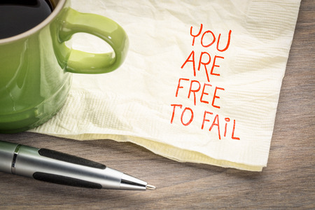 You are free to fail - handwriting on napkin with a cup of coffee