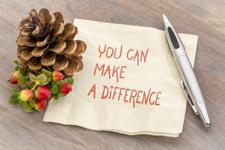 you can make a difference reminder - handwriting on a napkin Stock Photo
