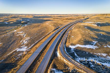 freeway across rolling prairie in northern Colorado - aerial view