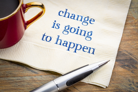 change is going to happen warning - handwriting on a napkin with a cup of coffee Stock Photo
