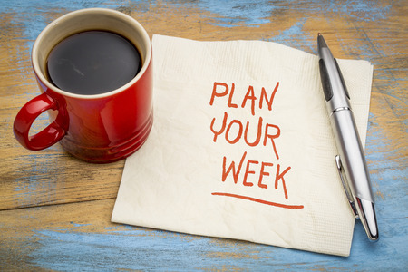 Plan your week - handwriting on a napkin with a cup of coffee Фото со стока